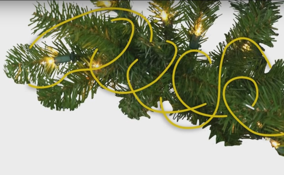 wrapping lights around christmas tree branches